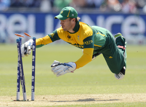 South Africa's A B de Villiers dives in an attempted run out of Ravindra Jadeja