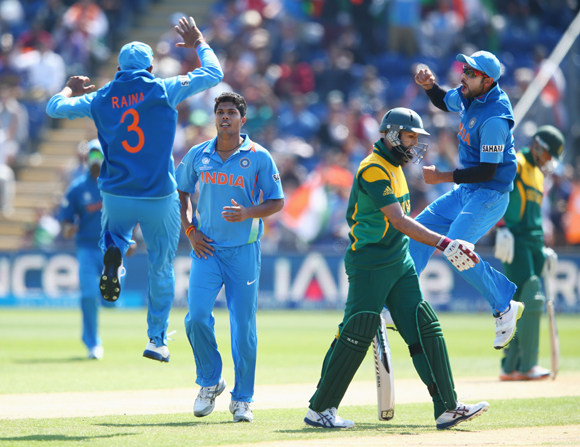 Hashim Amla of South Africa walks as Umesh Yadav (second left) of India captures his wicket