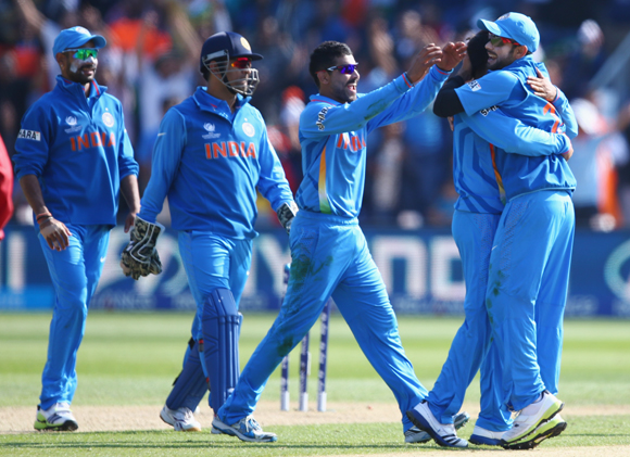 Ravindra Jadeja (C) of India leads the celebrations after a wicket