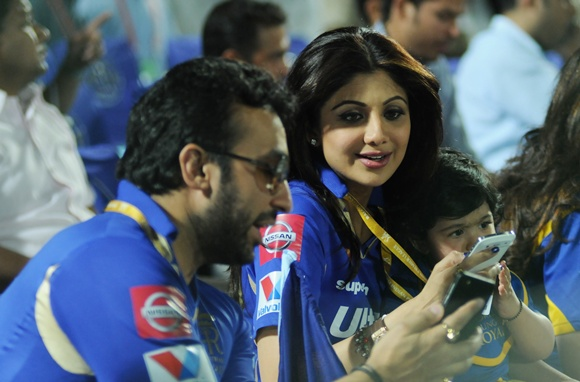 Raj Kundra with Shilpa Shetty and son during an IPL match