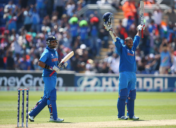 Shikhar Dhawan (R) of India celebrates reaching his century