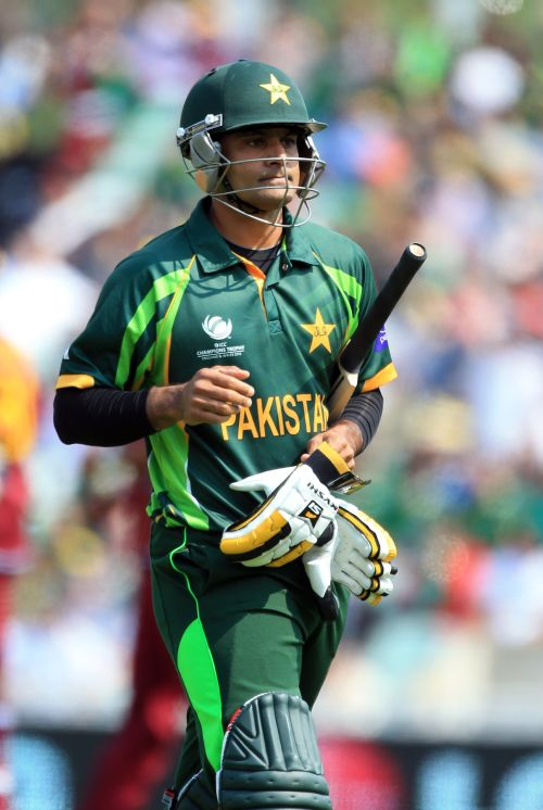 Mohammad Hafeez walks back to the pavilion