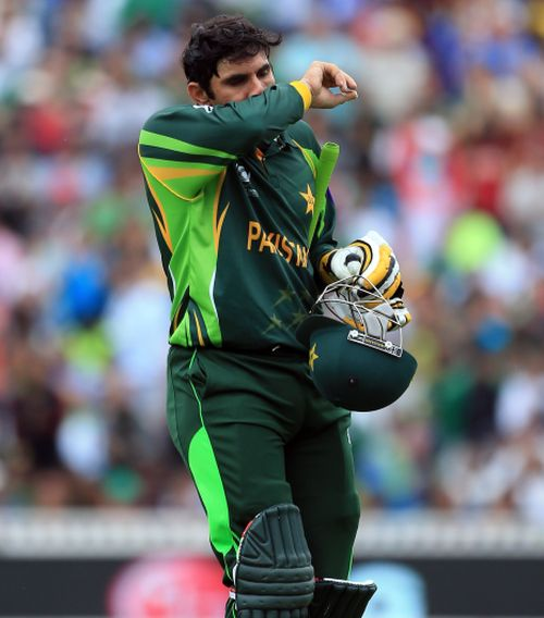 Misbah-ul-Haq walks back at the end of Pakistan's innings