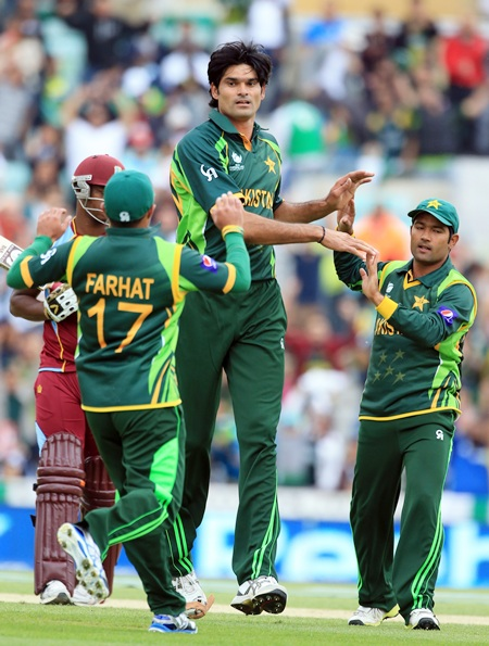 Muhammed Irfan celebrates taking the wicket of Johnson Charles