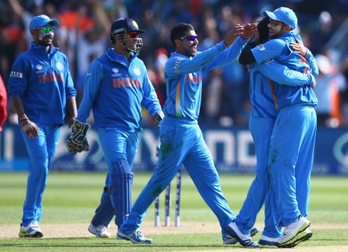 Ravindra Jadeja (C) of India leads the celebrations after a wicket during the Group B ICC Champions Trophy match between India and South Africa at the SWALEC Stadium on June 6, 2013 in Cardiff
