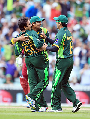 Saeed Ajmal of Pakistan celebrates taking the wicket of Chris Gayle of West Indies during the ICC Champions Trophy group at The Oval on Friday