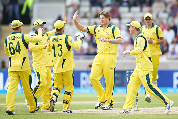 Shane Watson (2nd from right) of Australia celebrates capturing the wicket of Alastair Cook