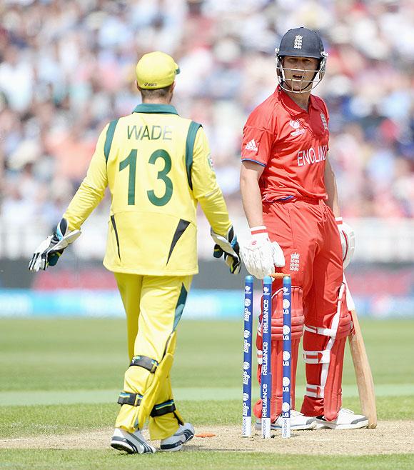 Jonathan Trott of England exchanges words with Australian wicketkeeper Matthew Wade