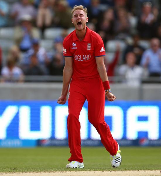Stuart Broad celebrates taking the wicket of David Warner