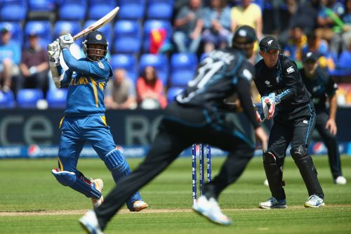 Kumar Sangakkara (L) plays to the offside as wicketkeeper Luke Ronchi (R) looks