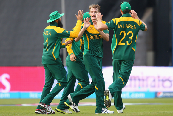 Chris Morris (C) of South Africa celebrates taking the wicket of Muhammad Hafeez of Pakistan with Hashim Amla (L) and Ryan McLaren (R) during the ICC Champions Trophy Group B match