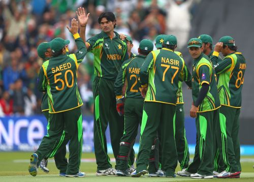 Mohammad Irfan celebrates with teammates after taking a wicket