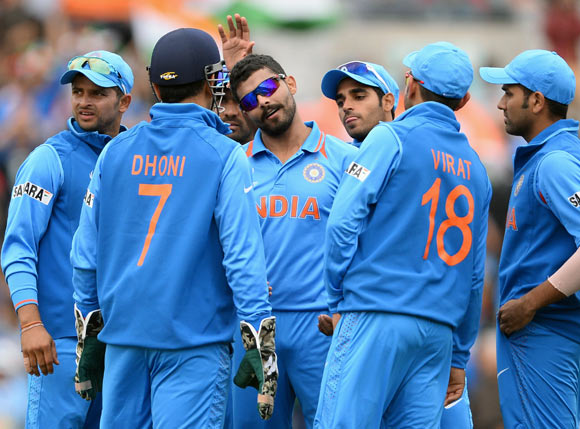 Ravinda Jadeja (centre) celebrates with team mates after dismissing Ramnaresh Sarwan
