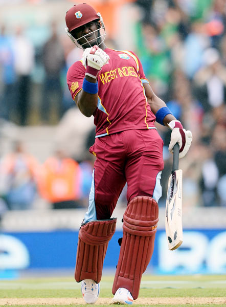 Darren Sammy celebrates after scoring a half-century