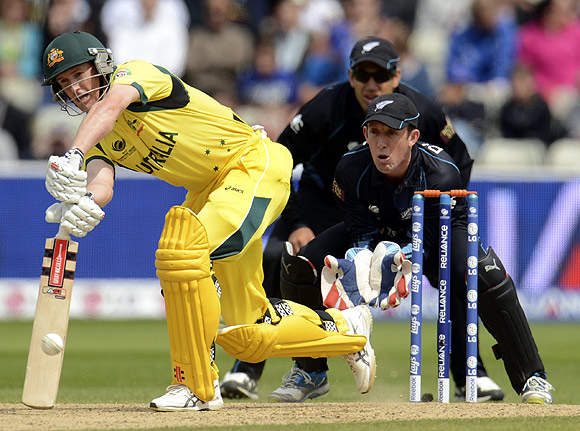 Australia's George Bailey (left) hits out watched by New Zealand's Ross Taylor and Luke Ronchi (front R) during the ICC Champions Trophy group A match at Edgbaston
