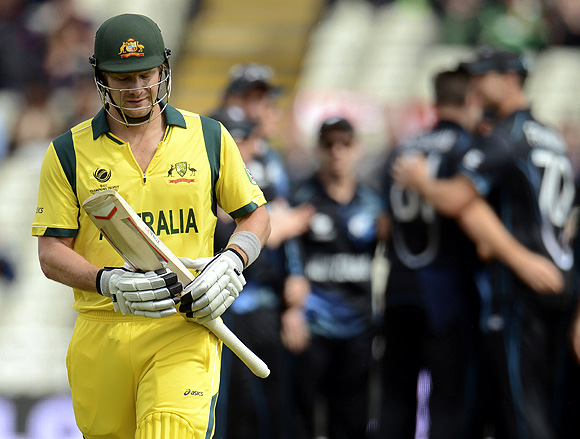 Australia's Shane Watson leaves the field after being dismissed