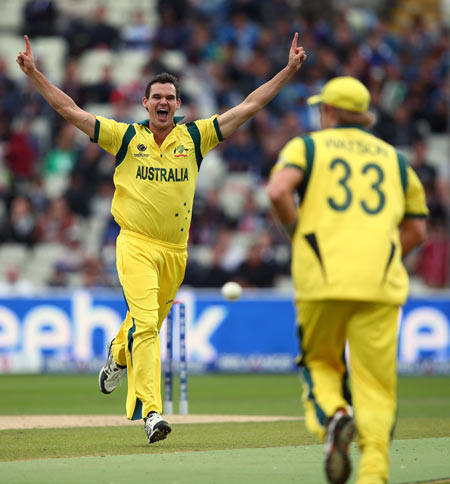 Clint McKay (left)of Australia celebrates