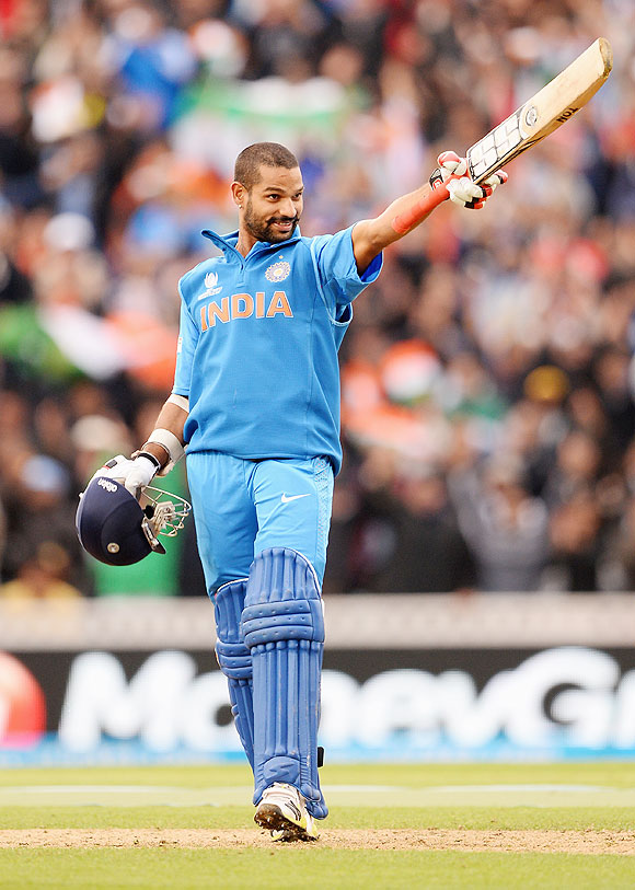 Shikar Dhawan celebrates on reaching his century