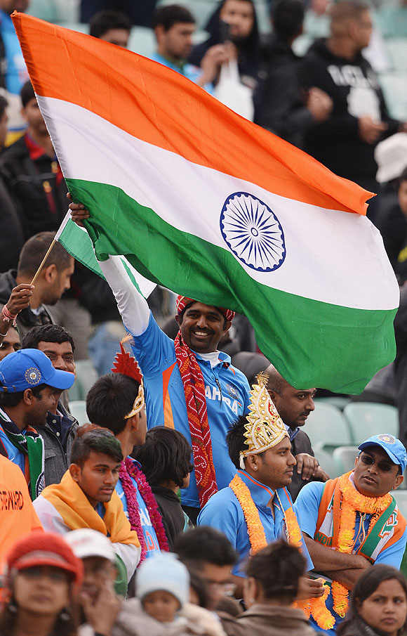 Indian fans celebrate India's win over West Indies on Tuesday