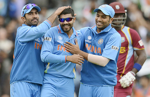 India's Ravindra Jadeja (centre) is congratulated by teammates Dinesh Karthik (left) and Rohit Sharma after dismissing West Indies' Ravi Rampaul