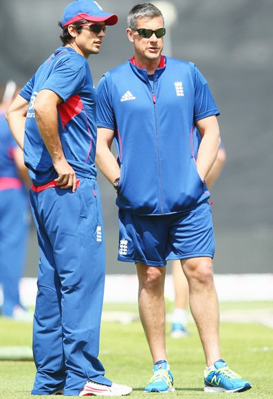 England captain Alastair Cook (left) in discussion with coach Ashley Giles