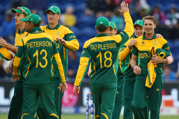 Dale Steyn (R) of South Africa accepts the congratulations from team mates after capturing the wicket of Johnson Charles of West Indies