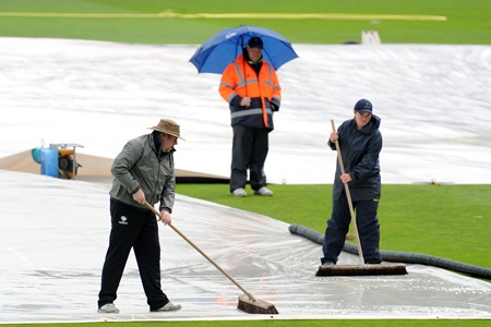 Groundsmen work overtime to get the field ready