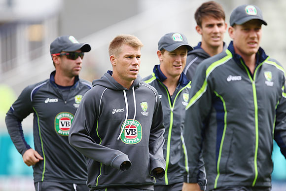 David Warner (2nd from left) warms up with his Australia teammates