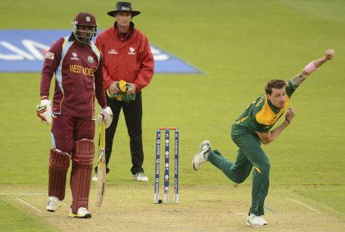 South Africa's Dale Steyn bowls as West Indies' Chris Gayle (left) and umpire Rod Tucker (centre) look on