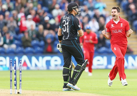 James Andeson (right) of England celebrates bowling Martin Guptill