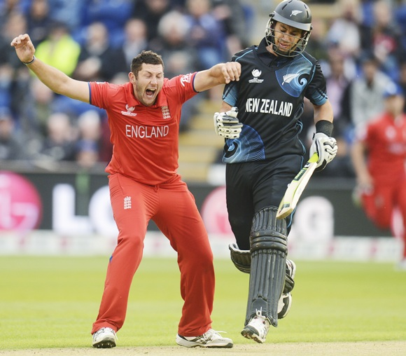 England's Tim Bresnan celebrates after dismissing New Zealand's Ross Taylor (right)