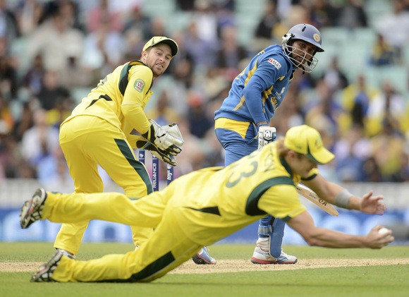 Sri Lanka's Tillakaratne Dilshan is caught by Australia's Shane Watson as Matthew Wade (left) lo