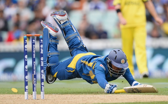 Tillakaratne Dilshan of Sri Lanka dives to make his ground