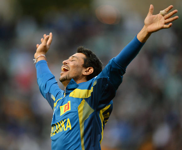 Tillakaratne Dilshan celebrates after taking the final wicket of Clint McKay