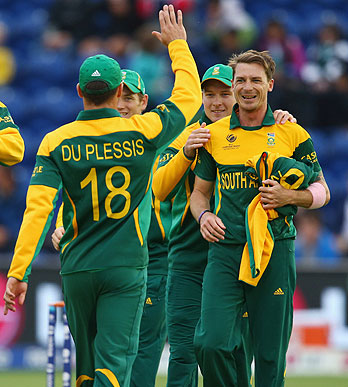 Dale Steyn (R) of South Africa accepts the congratulations from teammates