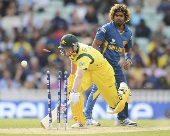 eorge Bailey is run out as Lasith Malinga looks on