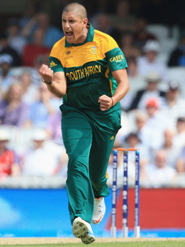 Rory Kleinveldt of South Africa celebrates taking the wicket of Ian Bell