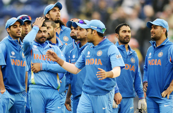India elect to bowl after rain delays start