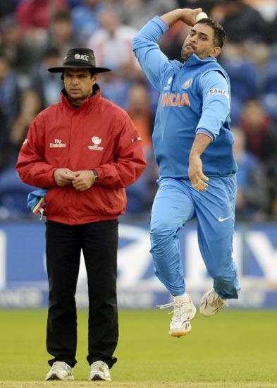 Mahendra Singh Dhoni bowls