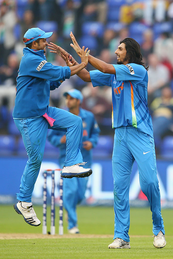 Ishant Sharma celebrates with Suresh Raina (left) after taking the wicket of Thisara Perera of Sri Lanka on Thursday