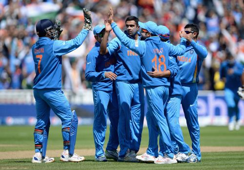 Indian team celebrate at the fall of a wicket