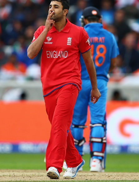 Ravi Bopara of England celebrates taking the wicket of Shikhar Dhawan