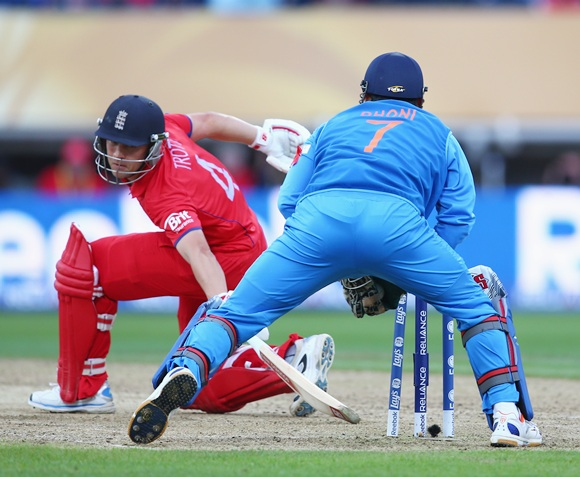 MS Dhoni (right) stumps Jonathan Trott