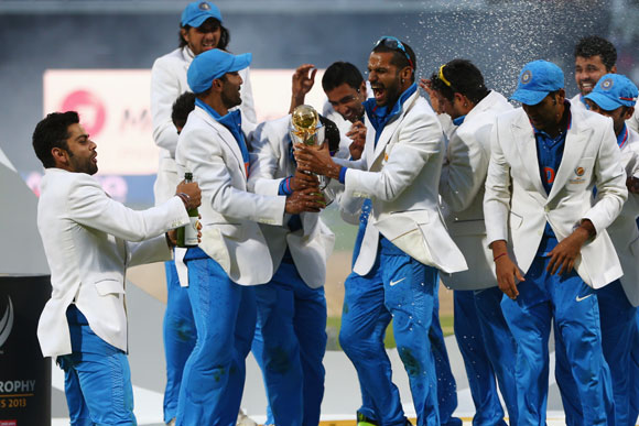 The India squad lift the winners trophy as they celebrate their win