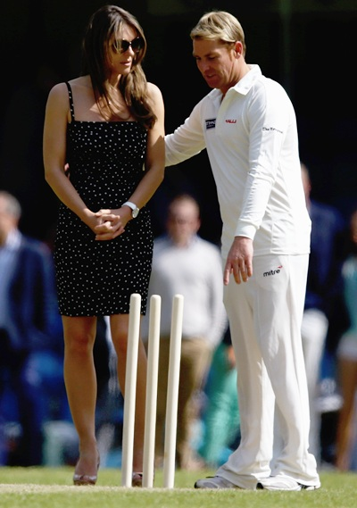 Elizabeth Hurley and Shane Warne look on during the Shane Warne's Australia vs Michael Vaughan's England T20 match