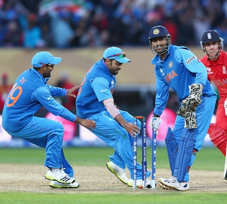 (from left) Dinesh Karthik, Suresh Raina and MS Dhoni pick a stump as souvenirs after victory is clinched
