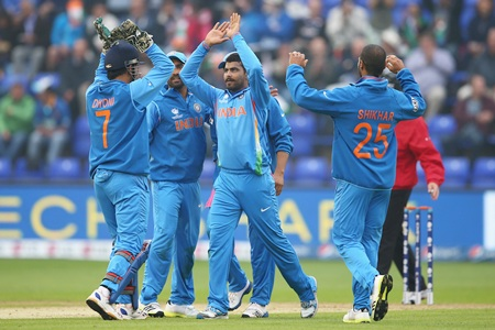 Ravindra Jadeja celebrates with teammates after taking a wicket
