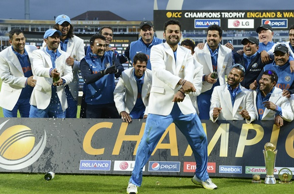 Virat Kohli of India dances in celebration