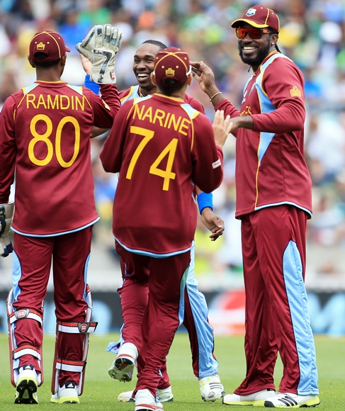 Dwyane Bravo of West Indies with teammates
