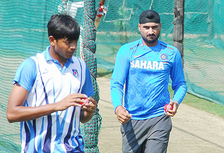 Harbhajan Singh and a local bowler at the nets session in Hyderabad on Thursday